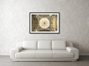 Framed fine photography print and wall art of the well-illuminated and ornately carved decorated dome of the Theatine Church in Munich Germany.