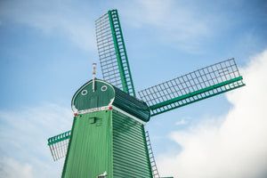 Fine photographic and art print of a single green windmill against a backdrop of blue dutch skies.