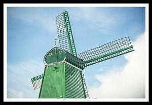 Framed fine photographic and art print of a single green windmill against a backdrop of blue dutch skies.