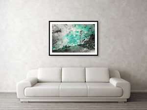 Framed fine photographic and wall art print of bright blue water melting off a glacier in Wrangell St Elias National Park in Alaska.
