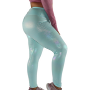 Fairy dust collection legging in Unicorn Frost. Made to stand out and shine, our all over iridescent print shimmers like the eyes of someone in love. High waisted to snatch you in where you need it, but also buttery soft enough to wear all day and night long. This Legging is high waisted for ultimate comfort and compression. The backside features a slight scrunch to accentuate your bum. scrunch butt, full length, shiny, high waisted. elle athletix