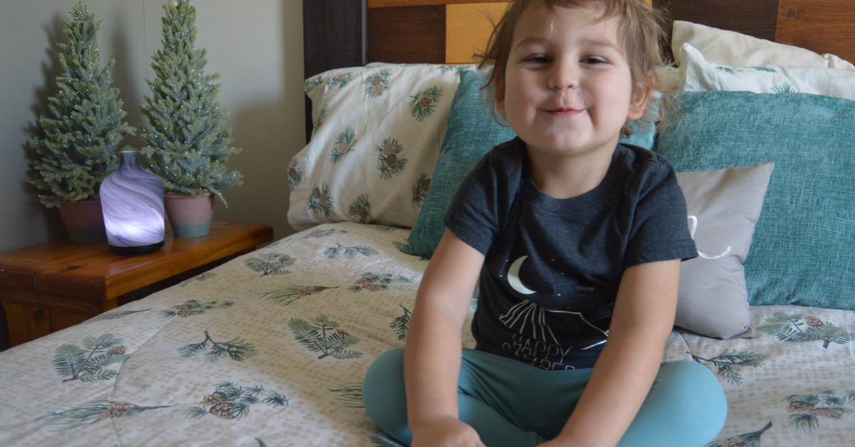 toddler sitting on bed