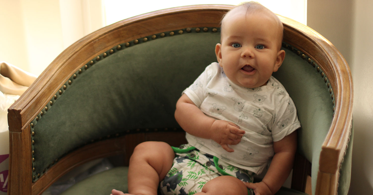 cloth diaper baby in chair