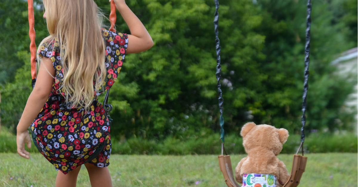 Child on Swing with teddy bear