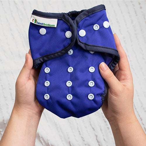Person holding Best Bottom One Size All in Two Cloth Diaper