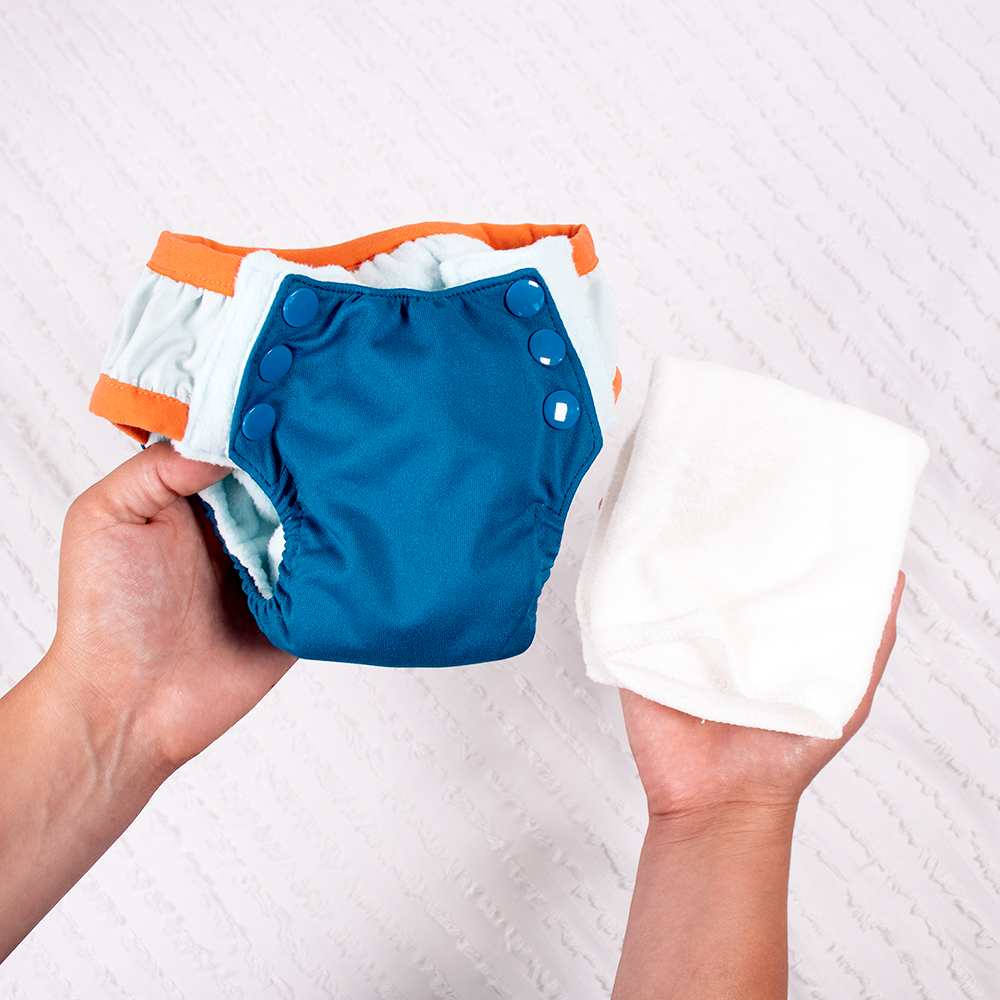 Person holding Nicki's Diapers Overnight Training Pants