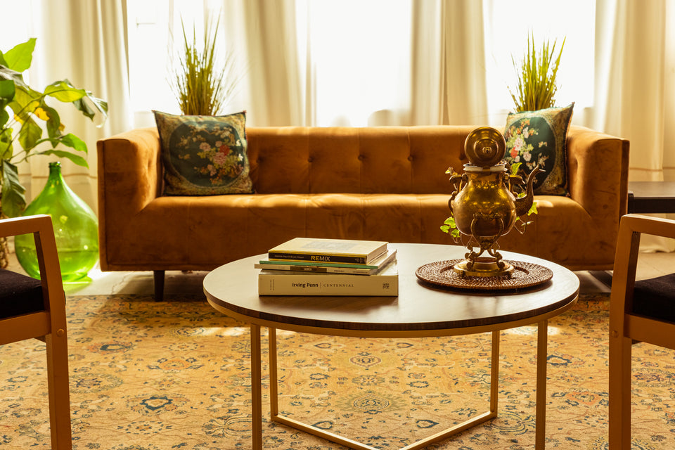 Studio Props - Brown Couch, Black Marble Coffee Table, Books, Antique Gold Lamp, and Plants.