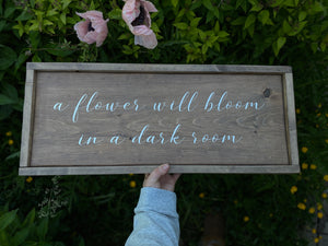 """A flower will bloom in a dark room"" Sign"