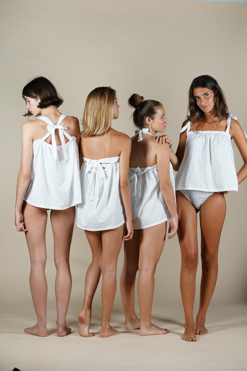Womens wearing white pijamas tops.