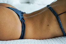 Load image into Gallery viewer, A woman wearing a grey blue brief made with satin fabric.