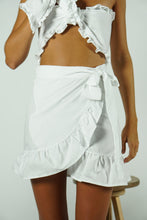 Load image into Gallery viewer, A woman wearing a white skirt.