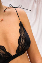 Load image into Gallery viewer, A woman wearing a satin black bralette.