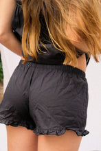Load image into Gallery viewer, A women wearing a black short pijama.