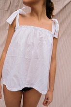 Load image into Gallery viewer, A women wearing a white pijama top.