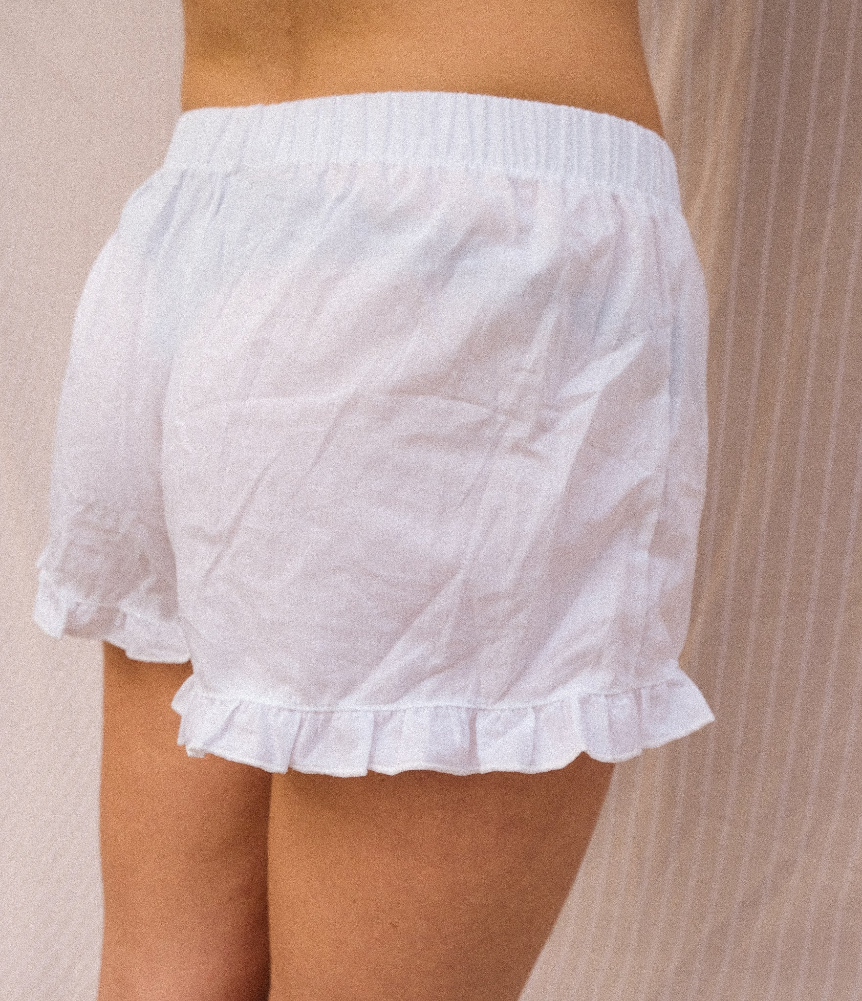 A women wearing a white short pijama.