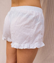 Load image into Gallery viewer, A women wearing a white short pijama.