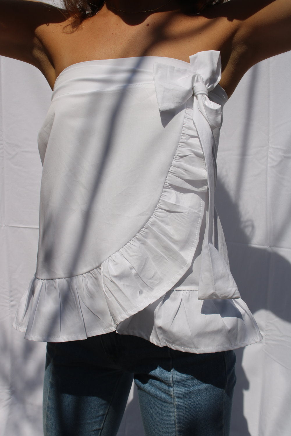A woman wearing a white skirt.