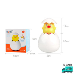 Yellow chick bath egg toy water sprinklers and squirt showing in box packaging with sizes