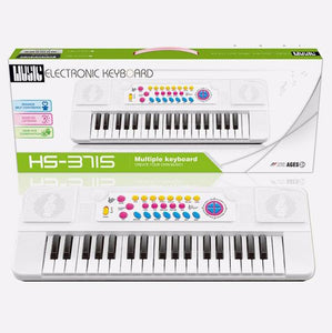 Electric piano keyboard toy with sound and music in box packaging