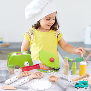 Girl pretend playing Wooden Cooking Kitchen Set