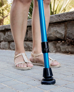 woman walking with crutches using esenium tac-55 crutch tips