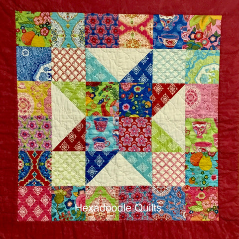 Charm Star Quilt designed by Hexadoodle Quilts using Moda Tradewinds Charm Pack