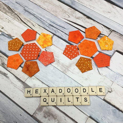 orange hexagon shapes surrounded by orange pentagons on all sides