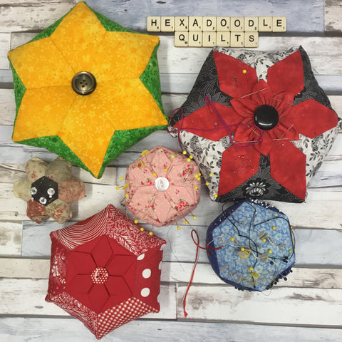 collection of handmade pincushions made with hexagons or hexagonal in shape