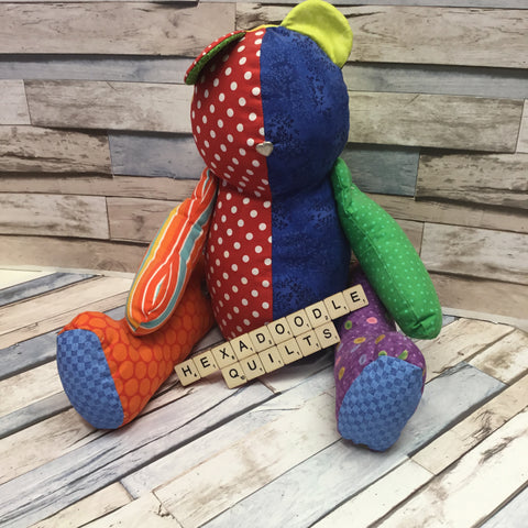 patchwork teddy bear made with various different scraps for each limb