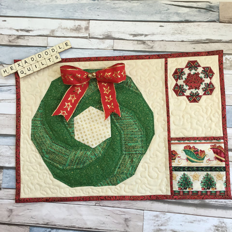 Festive Christmas Hexie Vortex EPP Placemat with Red Wired Ribbon Bow added