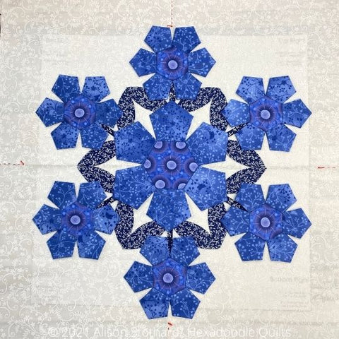 image of the Marigold block from Country Garden quilt by Alison Stothard showing 7 blooms with blue petals on a white background