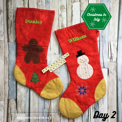 2 red handmade christmas stockings with machine embroidered names in acid green thread The stockings have gingerbread man, christmas tree and snowman appliques.  Machine embroidered snowflake in purple and white.