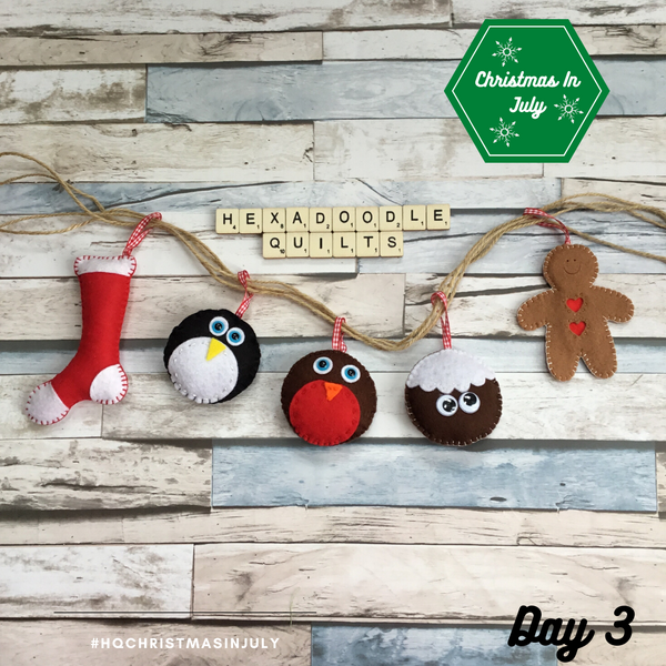 a handmade garland featuring hand stitched felt items including a christmas stocking, penguin, robin, christmas pudding and a gingerbread man