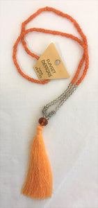 necklace - orange - crystal beads clear & metal ring beads - orange bead & tassle