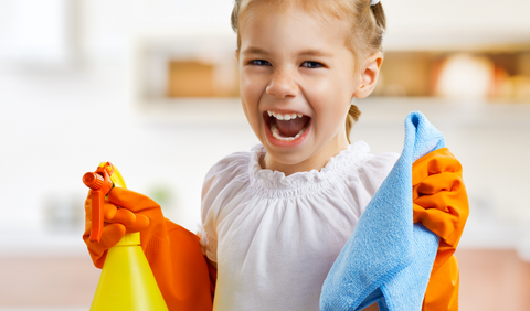 Child with cleaning spray bottle and cloth