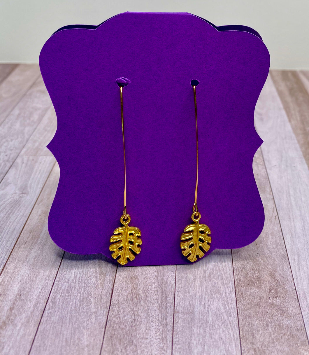 Gold Long Drop Earrings with Palm Leaf