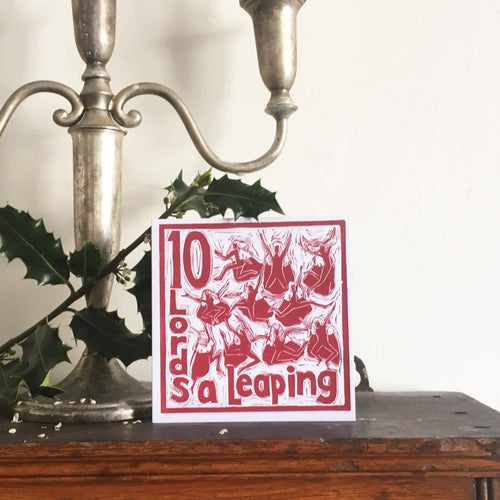 Ten Lords a Leaping Greetings Card lino cut by Kate Guy