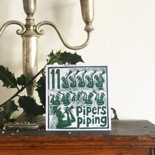 Eleven Pipers Piping Greetings Card lino cut by Kate Guy