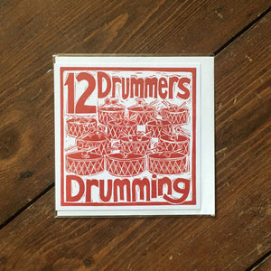 Twelve Drummers Drumming Greetings Card lino cut by Kate Guy
