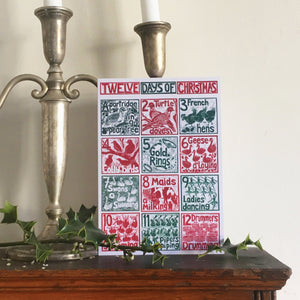 The Twelve days of Christmas Greetings Card lino cut by Kate Guy