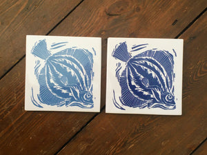 Plaice handmade tile trivet lino cut by Kate Guy pair in dark and light blue