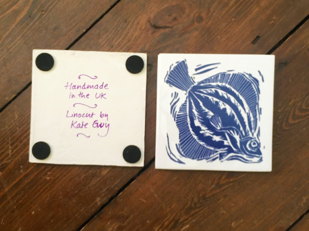 Plaice handmade tile trivet lino cut by Kate Guy showing front and back