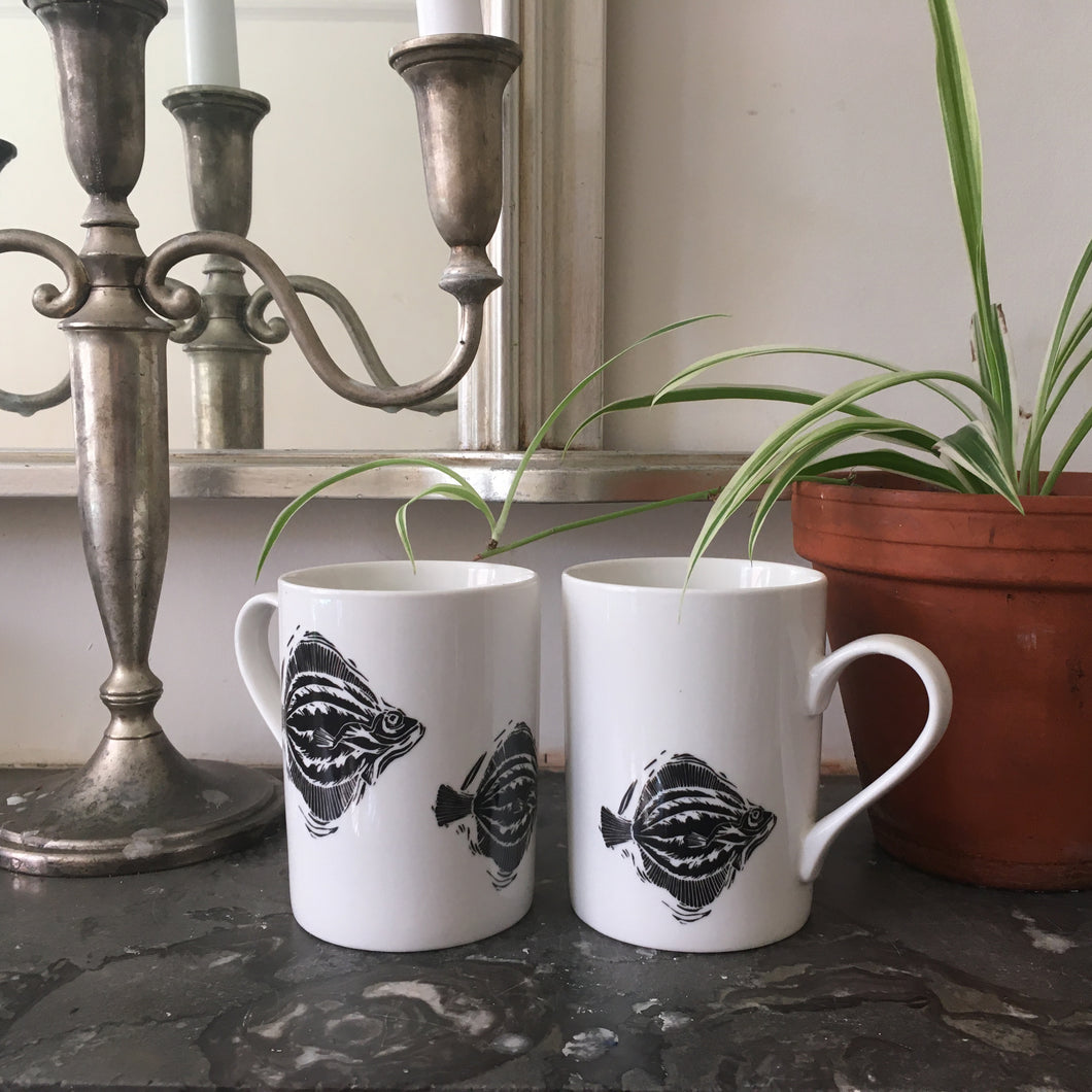 Porcelain fish mugs lino cut designs by Kate Guy