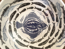 Load image into Gallery viewer, fish bowl, large porcelain bowl decorated with lino cut fish design in blue and black swirling towards the centre, unique by Kate Guy