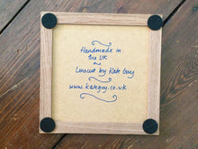 Load image into Gallery viewer, Plaice handmade framed tile trivet lino cut by Kate Guy in dark blue - back