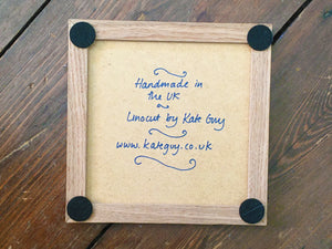 Sardines tile trivet in oak frame lino cut by Kate Guy back