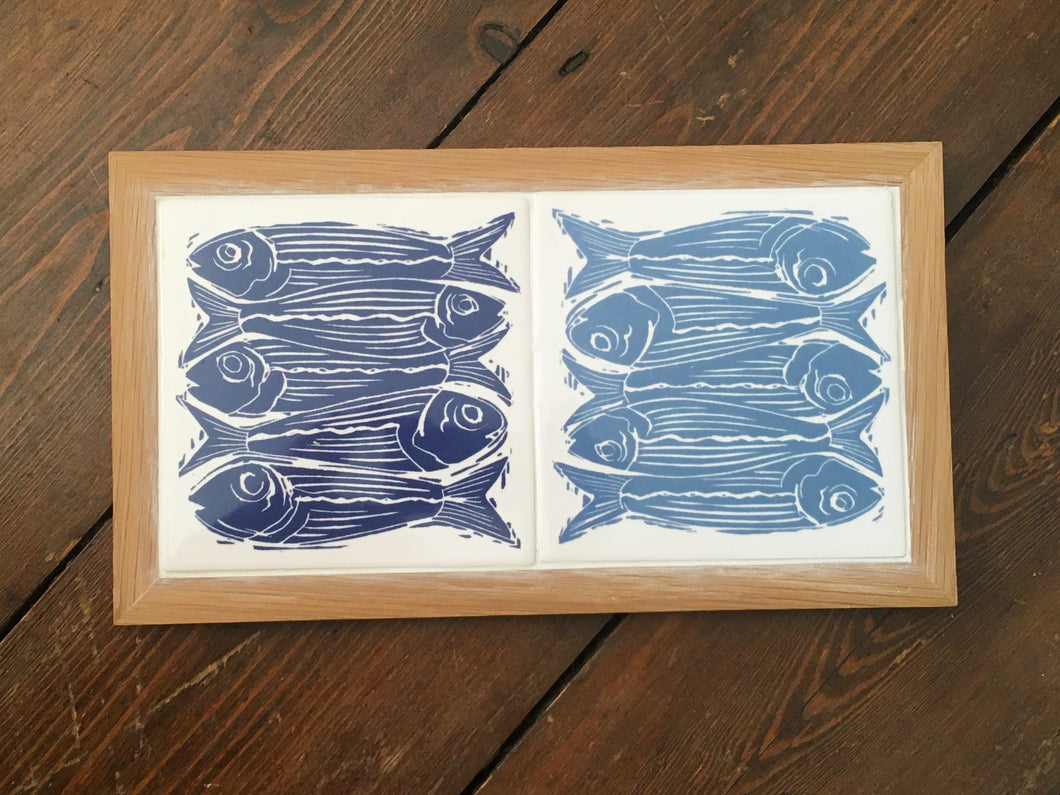Sardines tile trivets in oak frame lino cut by Kate Guy in dark and pale blue