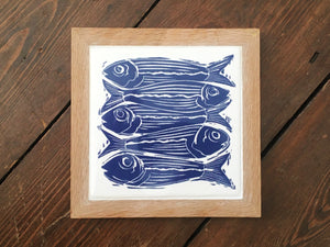 Sardines Handmade tile trivet, Linocut print of 5 fish ON HANDMADE TILE framed in English oak