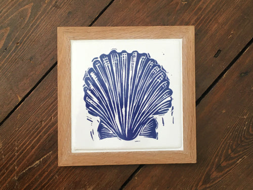 Scallop shell framed tile trivet in Prussian blue lino cut print by Kate Guy