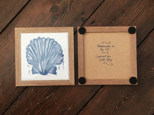 Scallop shell framed tile trivet in Prussian blue lino cut print by Kate Guy showing front and back